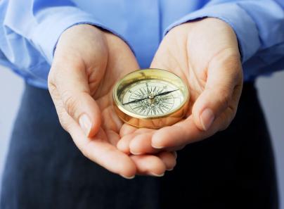 man-holding-compass